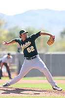 Chris Jensen #52 of the Oakland Athletics pitches during a Minor League Spring Training Game against the Los Angeles Angels at the Los Angeles Angels Spring Training Complex on March 17, 2014 in Tempe, Arizona. (Larry Goren/Four Seam Images)
