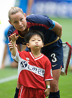 Christie Rampone, korean boy The USWNT defeated Canada, 1-0, at Suwon World Cup Stadium in Suwon, South Korea, to win the Peace Queen Cup.