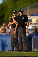 Umpires John Durante and Ryan Wilhelms during a game between the Vermont Lake Monsters and Batavia Muckdogs August 9, 2015 at Dwyer Stadium in Batavia, New York.  Vermont defeated Batavia 11-5.  (Mike Janes/Four Seam Images)
