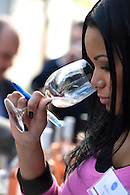 Taking in the aroma of a glass of wine.