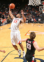 Dec. 22, 2010; Charlottesville, VA, USA; Virginia Cavaliers forward Mike Scott (23) grabs a rebound in front of Seattle Redhawks forward Gavin Gilmore (33) during the game at the John Paul Jones Arena. Seattle Redhawks won 59-53. Mandatory Credit: Andrew Shurtleff