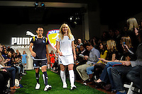 Los Angeles Sol players Marta and Johanna Frisk walk the runway during the unveiling of the Women's Professional Soccer uniforms at the Event Place in Manhattan, NY, on February 24, 2009. Photo by Howard C. Smith/isiphotos.com