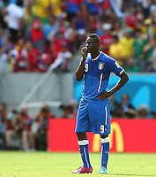 Mario Balotelli of Italy shows a look of dejection after Bryan Ruiz of Costa Rica scores a goal to make the score 1-0