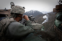 US Army Soldiers from Viper Company 126, 1st Platoon return fire during a fire fight at Restrepo Firebase in the restive Korengal Valley. Restrepo, a remote outpost, is known as one of the most violent places in Afghanistan. Located in the Korengal Valley it comes under fire on a daily basis from Anti-Afghan Forces in the local villages and mountains.