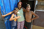 A woman and two boys in Suto Orizari, Macedonia. The mostly Roma community, located just outside Skopje, is Europe's largest Roma settlement. .