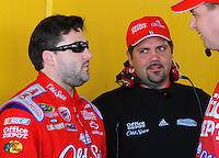 Feb 07, 2009; Daytona Beach, FL, USA; Darian Grubb (right) talks to NASCAR Sprint Cup Series driver Tony Stewart during practice for the Daytona 500 at Daytona International Speedway. Mandatory Credit: Mark J. Rebilas-