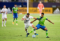 CARSON, CA - SEPTEMBER 27: Perry Kitchen #2 of the Los Angeles Galaxy battles for the ball against Kelvin Leerdam #18 of the Seattle Sounders during a game between Seattle Sounders FC and Los Angeles Galaxy at Dignity Heath Sports Park on September 27, 2020 in Carson, California.