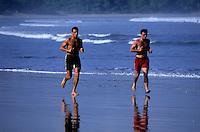 Jogging early morning on Kuta Beach Bali Indonesia
