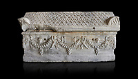 Roman relief sculpted garland sarcophagus with pitched tile sculpted roof, 3rd century AD. Adana Archaeology Museum, Turkey. Against a black background