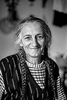 'Nana' (grandmother), a Bosnian matriarch at the Varazdin refugee camp in the winter of 1992. <br /> <br /> In 1992 while volunteering at the Varazdin refugee camp Panos photographer Bjoern Steinz met and became close to Elvis, a Bosnian Muslim refugee, and his family. They shared the hardships of camp life together which Steinz documented. While the prints were archived for many years two of the images always returned to Bjoern's thoughts. 25 years later he set out to try and find out what had happened to Elvis and his family in the intervening years. Modern social media made the task surprisingly easy and they were reunited in Hadzici where Elvis now lives with his family.