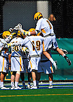 17 March 2012: University of Vermont Catamount Attackman/Midfielder Garrett Virtue, a Junior from Rye, NY, jumps high to join the celebration of a goal against the Sacred Heart University Pioneers at Virtue Field in Burlington, Vermont. The Catamounts defeated the visiting Pioneers 12-11 with only 10 seconds remaining in their non-conference matchup. Mandatory Credit: Ed Wolfstein Photo