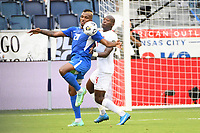 KANSASCITY, KS - JULY 11: Stephane Abaul #20 of Martinique ,Kamal Miller #4 of Canada during a game between Canada and Martinique at Children's Mercy Park on July 11, 2021 in KansasCity, Kansas.