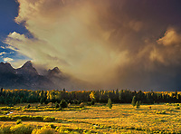 749450007 the sun filters through a magnificent cloud bank hovering above the teton range as viewed from blacktail ponds overlook in Grand Tetons National Park, Wyoming