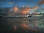 Reflection of clouds on Kailua Beach of Oahu, Hawaii.