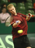 12-2-06, Netherlands, tennis, Amsterdam, Daviscup.Netherlands Russia,  Dmitry Tursunov in action against Melle van Gemerden