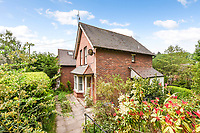 BNPS.co.uk (01202 558833)<br /> Pic: Homesestateagency/BNPS<br /> <br /> Pictured: The side of the house.<br /> <br /> A timewarp home that has been lived in by the same family for more than a century has gone on sale for the first time since being built.<br /> <br /> At the time the property was built, King Edward VII was on the throne and the First World War had not even started.<br /> <br /> The property is being sold for £550,000 under probate by the original builder's three grandchildren, who were born in the Victorian-style house.<br /> <br /> The two-bedroomed home is in the Surrey town of Haslemere and belonged to the Berry family, who decided to sell after the death of their parents, Freda and Leslie.