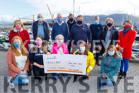 The Churchill drama players present a cheque for €1,500 to the RNLI in Fenit on Saturday.<br /> Kneeling l to r: Susan and Linda Brown, Maura McCarthy, Denise Lynch and Deirdre O'Brien.<br /> Back l to r: Veronica Kelly, John Scroops, Fionnbar Walsh, Michael O'Sullivan, Mike O'Connor, Declan O'Halloran, Aine Quinn and Marie Hill.