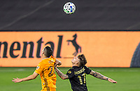 CARSON, CA - OCTOBER 28: Brian Rodriguez #17 of LAFC and Matias Vera #22 of the Houston Dynamo look to the skies waiting for the ball to drop during a game between Houston Dynamo and Los Angeles FC at Banc of California Stadium on October 28, 2020 in Carson, California.