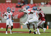 Ole Miss defensive back Jon Haynes (5) intercepts a pass intended for Arkansas wide receiver Treylon Burks (16), Saturday, October 17, 2020 during the third quarter of a football game at Donald W. Reynolds Razorback Stadium in Fayetteville. Check out nwaonline.com/201018Daily/ for today's photo gallery. <br /> (NWA Democrat-Gazette/Charlie Kaijo)
