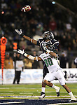 Nevada defender Marlon Johnson (8) and Hawaii receiver Jeremiah Ostrowski battle for a ball in the third quarter of an NCAA football game in Reno, Nev., on Saturday Nov. 12, 2011. (AP Photo/Cathleen Allison)