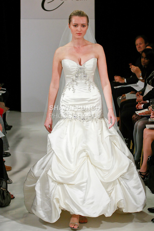 Model walks the runway in wedding dress from the Simone Carvalli Spring 2011 Haute Couture Bridal Collection, for the Simone Carvalli Spring 2011 fashion show, during the WeddingChannel Couture Show Spring 2011.