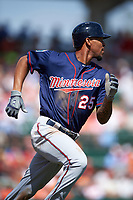 Minnesota Twins center fielder Byron Buxton (25) runs to first base during a Spring Training game against the Baltimore Orioles on March 7, 2016 at Ed Smith Stadium in Sarasota, Florida.  Minnesota defeated Baltimore 3-0.  (Mike Janes/Four Seam Images)