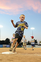 Young fans run the bases after a Batavia Muckdogs game against the Auburn Doubledays on August 31, 2014 at Dwyer Stadium in Batavia, New York.  Batavia defeated Auburn 7-6.  (Mike Janes/Four Seam Images)