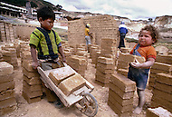 Children work at a brick manufactuer in Colombia - Child labor as seen around the world between 1979 and 1980 - Photographer Jean Pierre Laffont, touched by the suffering of child workers, chronicled their plight in 12 countries over the course of one year.  Laffont was awarded The World Press Award and Madeline Ross Award among many others for his work.