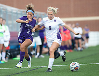Jayden Tyler (12) of Fayetteville and Ava Mc Crary (9) of Mount Saint Mary's Academy fight for ball at Wildcat Stadium, Springdale, Arkansas, Friday, May 14, 2021 / Special to NWA Democrat-Gazette/ David Beach