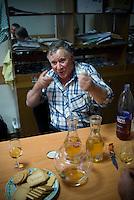REPUBLIC OF MOLDOVA, Gagauzia, Comrat, 2009/06/25..Trofim Ivanovich Karabatchak, passionate about literature and wine, is tasting  a wine after visiting Vinex, Tomai cooperative winery where he works..© Bruno Cogez / Est&Ost Photography..REPUBLIQUE MOLDAVE, Gagaouzie, Tomai, 25/06/2009..Trofim Ivanovitch Karabatchak, passionne de littérature et de vin, fait deguster son vin apres la visite de Vinex, la cooperative vinicole de Tomai ou il travaille..© Bruno Cogez / Est&Ost Photography