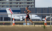 28 JUL 2013 - LONDON, GBR - An age group competitor makes his way out to the turn by Building 1000, across the river from City Airport, during the run at the 2013 Virgin Active London Triathlon at Royal Victoria Dock in London, Great Britain (PHOTO COPYRIGHT © 2013 NIGEL FARROW, ALL RIGHTS RESERVED)