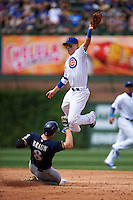 Chicago Cubs second baseman Chris Coghlan (8) jumps for a throw as Ryan Braun (8) skies in during a game against the Milwaukee Brewers on August 13, 2015 at Wrigley Field in Chicago, Illinois.  Chicago defeated Milwaukee 9-2.  (Mike Janes/Four Seam Images)