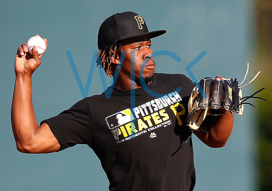 Gift Ngoepe #61 of the Pittsburgh Pirates fields ground balls during spring training at Pirate City in Bradenton, Florida on February 18, 2016. (Photo by Jared Wickerham / DKPS)