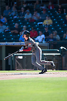 Salt River Rafters first baseman Pavin Smith (44), of the Arizona Diamondbacks organization, follows through on his swing during an Arizona Fall League game against the Surprise Saguaros on October 9, 2018 at Surprise Stadium in Surprise, Arizona. The Rafters defeated the Saguaros 10-8. (Zachary Lucy/Four Seam Images)