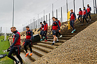 (L-R) Players climb the steps down to the pitch to the pitch during the Swansea City Training Session and Press Conference at The Fairwood Training Ground, Wales, UK. Thursday 29 March 2018