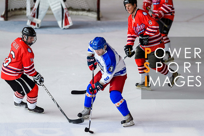 Josef Reznicek of Old Boys Pilsen Indians (C) in action against Bruce Galba of Kowloon Generals (L) during the Mega Ice Hockey 5s match between Old Boys Pilsen Indians and Kowloon Generals on May 04, 2018 in Hong Kong, Hong Kong. Photo by Marcio Rodrigo Machado / Power Sport Images