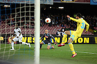 Thursday 27 February 2014<br /> Pictured L-R: Marvin Emnes of Swansea in a near miss to score a goal against Pepe Reina goalkeeper for Napoli, Raul Albiol kicks the ball away<br /> Re: UEFA Europa League, SSC Napoli v Swansea City FC at Stadio San Paolo, Naples, Italy.