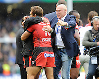 Bernard Laporte, RC Toulon Director of Rugby, congratulates his captain Jonny Wilkinson after winning the Heineken Cup Final between ASM Clermont Auvergne and RC Toulon at the Aviva Stadium, Dublin on Saturday 18th May 2013 (Photo by Rob Munro)