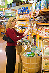 Young woman selecting items at a grocery store