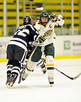 11 February 2011: University of Vermont Catamount forward Celeste Doucet, a Senior from Memramcook, New Brunswick, in action against the University of New Hampshire Wildcats at Gutterson Fieldhouse in Burlington, Vermont. The Lady Catamounts defeated the visiting Lady Wildcats 4-2 in Hockey East play. Mandatory Credit: Ed Wolfstein Photo