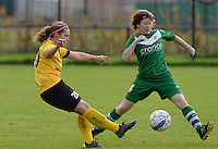 20151024 - ZWEVEZELE , BELGIUM : Emily Van Loon pictured defending on Celine Vandekerckhove (left) during a soccer match between the women teams of SKV Zwevezele Ladies and KSOC Maria Ter Heide  , during the eight matchday in the Third League - Derde Nationale season, Saturday 24 October 2015 . PHOTO DAVID CATRY