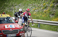 Stage leader Rui Costa (POR/Lampre-Merida) receives some 'documents' (actually the riders list...) from the race officials before descending from the highest point in the 2016 Tour; the Port d'Envalira (Cat1/2408m/22.6km at 5.5%) to protect him from the cold ahead (as his teamcar wasn't able to pass the peloton coming up to provide protective clothing)<br /> <br /> stage 10: Escaldes-Engordany (AND) - Revel (FR)<br /> 103rd Tour de France 2016
