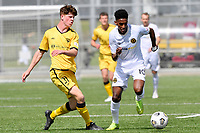 Nati Hailemariam of Team Wellington competes for the ball with Adam Hillis of the Wellington Phoenix during the ISPS Handa Men's Premiership - Wellington Phoenix v Team Wellington at Fraser Park, Wellington on Saturday 14 November 2020.<br /> Copyright photo: Masanori Udagawa /  www.photosport.nz
