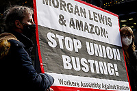 NEW YORK, NEW YORK - MARCH 04: People hold a placard during a protest to support Amazon workers in Alabama on March 04, 2021 in New York. Amazon is the second largest employer in the United States - with 400,000 workers and about 1.3 million employees worldwide. (Photo by Emaz/VIEWpress)