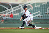 Kannapolis Intimidators first baseman Michael Hickman (18) reaches for a throw during the game against the Lakewood BlueClaws at Kannapolis Intimidators Stadium on April 8, 2018 in Kannapolis, North Carolina.  The Intimidators defeated the BlueClaws 4-3 in game two of a double-header.  (Brian Westerholt/Four Seam Images)