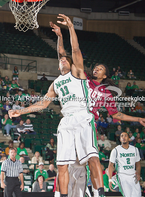 North Texas Mean Green forward Tony Mitchell (13) and Troy Trojans forward Tim Owens (42) in action during the game between the Troy Trojans and the University of North Texas Mean Green at the North Texas Coliseum,the Super Pit, in Denton, Texas. UNT defeats Troy 87 to 65.....
