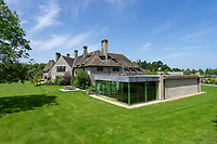 BNPS.co.uk (01202 558833)<br /> Pic: Hamptons/BNPS<br /> <br /> Pictured: The house and gardens.<br /> <br /> An incredible Arts and Crafts country house with its own vineyard is on the market for offers over £7m.<br /> <br /> The Grade II listed St Joseph's Hall is a striking 111-year-old property that was home to the Bishop of Arundel for 40 years.<br /> <br /> It has a wealth of period features, an indoor swimming pool and seven acres of vineyard with mostly Chardonnay grapes, which the owners sell to a local winery.<br /> <br /> The house in Storrington, West Sussex, has 17 acres of land with beautiful views over the South Downs.