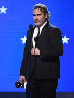 SANTA MONICA, CA - JANUARY 12: Joaquin Phoenix accepts the Best Actor award for 'Joker' onstage at the 25th Annual Critics' Choice Awards at the Barker Hangar on January 12, 2020 in Santa Monica, California. (Photo by Frank Micelotta/PictureGroup)