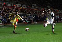 Swansea, UK. Thursday 20 February 2014<br /> Pictured L-R: Jose Callejon of Napoli has his cross blocked by Ben Davies of Swansea.<br /> Re: UEFA Europa League, Swansea City FC v SSC Napoli at the Liberty Stadium, south Wales, UK
