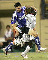 23 July 2005: Danny Califf of Earthquakes controls the ball away from Abbe Ibrahim of MetroStars during the second half of the game at Spartan Stadium in San Jose, California.  Earthquakes defeated MetroStars, 2-1.